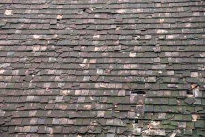 Old Damaged Asphalt Roof