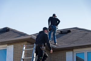 Roofers Inspecting for damage