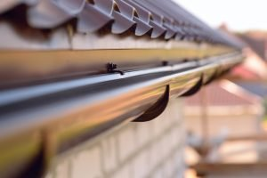 Metal gutters installed on home