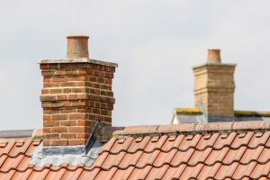 Chimney on tile roof with new flashing