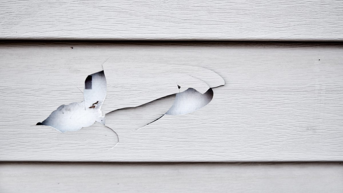 Hole in home's exterior siding